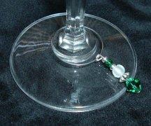 Emerald crystal wine charm